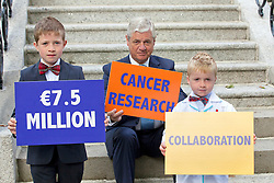 Repro Free: 17/09/2012.Oran (8) and Fionn O'Hagan (5) from Dun Laoghaire are pictured helping Prof. John Fitzpatrick, Head of Research at the Irish Cancer Society today announce that the Society has taken a major step forward to deliver its vision for cancer research in Ireland, by allocating ?7.5 million in funding to establish a Collaborative Cancer Research Centre in Ireland. This equates to ?1.5 million in funding being allocated per year, for up to five years. Pic Andres Poveda.