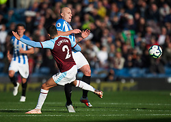 Matthew Lowton of Burnley (L) and Aaron Mooy of Huddersfield Town in action - Mandatory by-line: Jack Phillips/JMP - 06/10/2018 - FOOTBALL - Turf Moor - Burnley, England - Burnley v Huddersfield Town - English Premier League