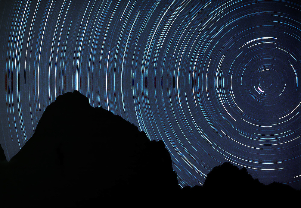 A seven-hour exposure creates a circular star trail over the Huangshan Mountains in China.