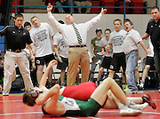 Catoosa head coach Darren Peaster (center) reacts to a point by his wrestler during the Dual State Wrestling Championship in Oklahoma City, OK.