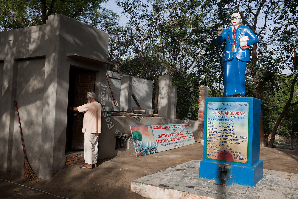The statue of B. R. Ambedkar, the father founder of the Indian Constitution, is standing next to a small Hindu temple opposite the Taj Mahal, on the banks of the heavily polluted Yamuna River.
