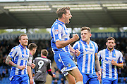 Colchester Utd forward Chris Porter celebrates after scoring his and Colchester's second goal during the EFL Sky Bet League 2 match between Colchester United and Morecambe at the Weston Homes Community Stadium, Colchester, England on 22 October 2016. Photo by Nigel Cole.