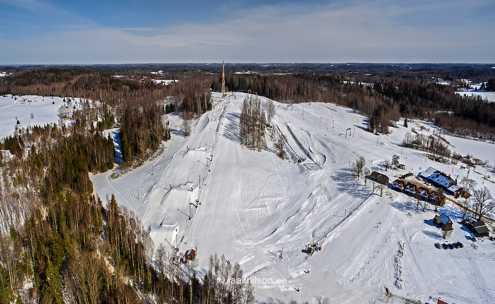 Kuutsemäe ski resort, Estonia. Aerial, hilly landscape, forest. Small cabins.