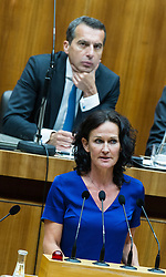 13.09.2016, Parlament, Wien, AUT, Parlament, Nationalratssitzung, Sondersitzung des Nationalrates auf Anfrage von FPÖ zum Thema Asylpolitik, im Bild Grüne Klubobfrau Eva Glawischnig vor Bundeskanzler Christian Kern (SPÖ) // Leader of the parliamentary group the greens Eva Glawischnig<br />  in front of Federal Chancellor of Austria Christian Kern during meeting of the National Council of austria at request of the austrian freedom party with topic Asylum policy at austrian parliament in Vienna, Austria on 2016/09/13, EXPA Pictures © 2016, PhotoCredit: EXPA/ Michael Gruber