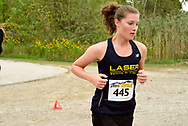 """Windsor, Ontario, Canada. 2017. Alexandria MacLellan competes for St. Joseph's Catholic High School in the annual """"Thrill on the Hill"""" at Malden Park. MacLellan finishes the 5 km run in 30th spot."""