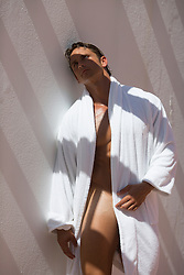 man in an open white terry cloth robe with nothing else on