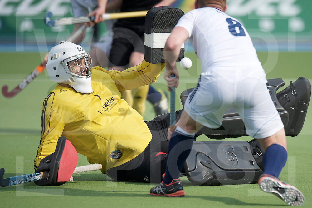 Amstelveen - Euro Hockey league KO16.Beeston HC - East Grinstead .foto: Goalie George Pinner stopping Andrew Piper..FFU PRESS AGENCY COPYRIGHT FRANK UIJLENBROEK.