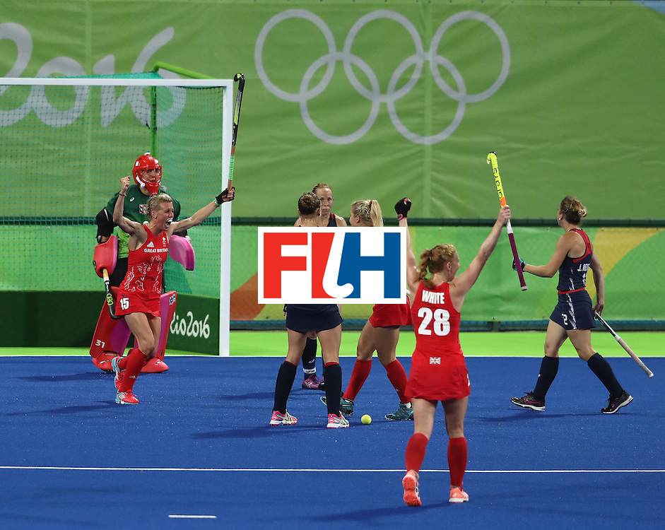 RIO DE JANEIRO, BRAZIL - AUGUST 13:  Alex Danson  (L) of Great Britain celebrates after scoring their second goal during the Women's group B hockey match between Great Britain and the USA on Day 8 of the Rio 2016 Olympic Games at the Olympic Hockey Centre on August 13, 2016 in Rio de Janeiro, Brazil.  (Photo by David Rogers/Getty Images)