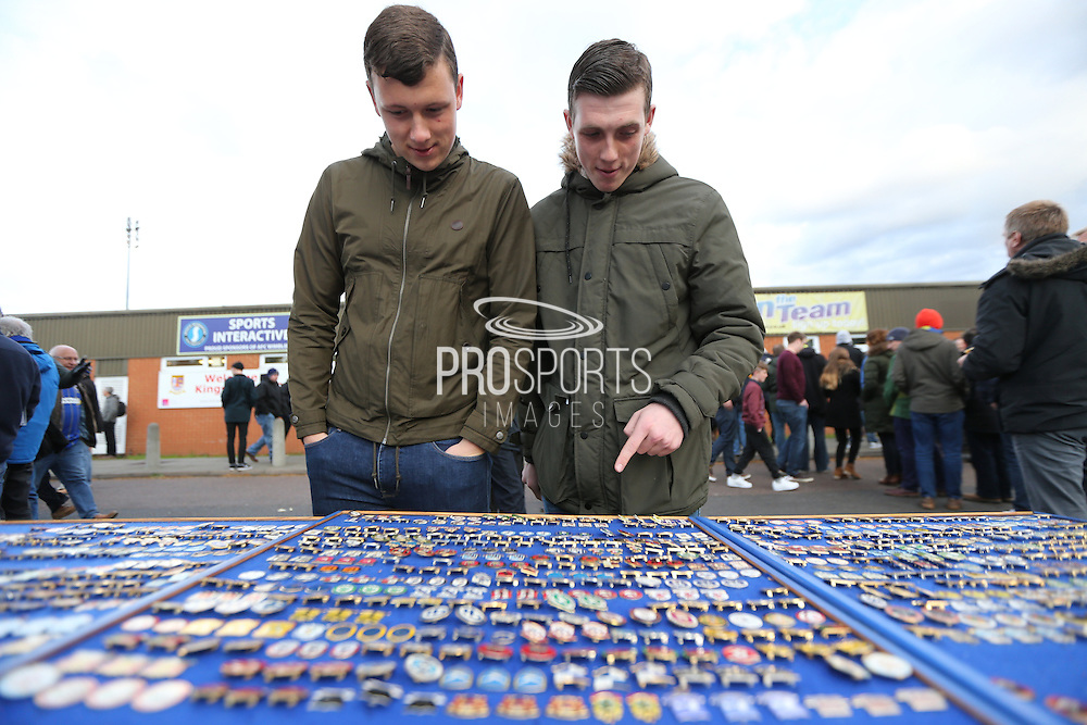 Wimbledon fans looking at pin badges for sale before the Sky Bet League 2 match between AFC Wimbledon and Portsmouth at the Cherry Red Records Stadium, Kingston, England on 26 April 2016.
