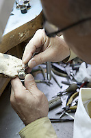 Close-up of a skilled worker repairing ring in workshop