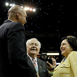 April 19, 2012; New Orleans, LA, USA; New Orleans Hornets and Saints owner Tom Benson and his wife Gayle Benson talk to head coach Monty Williams following a win over the Houston Rockets at the New Orleans Arena. The Hornets defeated the Rockets 105-99.   Mandatory Credit: Derick E. Hingle-US PRESSWIRE