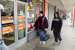 1/27/15 11:34:09 AM -- Louisa, KY, U.S.A  -- Cheryl Castle, left, goes to AutoZone for her son Mitchell (not pictured) to purchase a part for his truck with her son Nate, right, on Tuesday. <br /> <br /> Cheryl's mother Alice drove her around but with the NueroPace nuerostimulator Cheryl will at least get out now where before she was embarrassed she may have a seizure in public. <br /> <br /> Castle is a recent recipient of the high-tech device, can now do many tasks she was unable to do when her epileptic seizures became more severe and more frequent. Now she's getting back to a normal life.<br /> <br />  --    Photo by Jonathan Palmer, Freelance