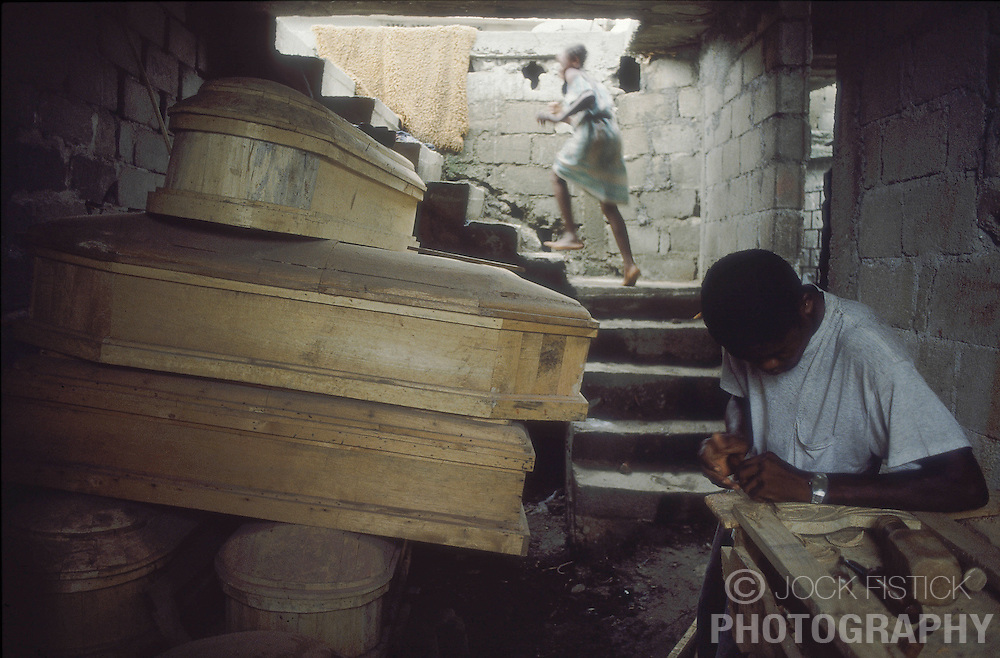 CAP HAITIEN, HAITI - Coffin-making is one of the few thriving businesses in Cap Haitien.(PHOTO © JOCK FISTICK)....