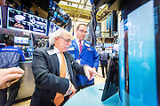 At the NYSE Euronext Stock Exchange, floor specialists Peter M. Tuchman (left) with Quattro Securities and Anthony M. Matesic with Barclays start trading again after the announcement that the federal interest rate would increase.