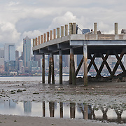 Alki Beach at low tide, with the city of Seattle in the background.  Photo by William Byrne Drumm.
