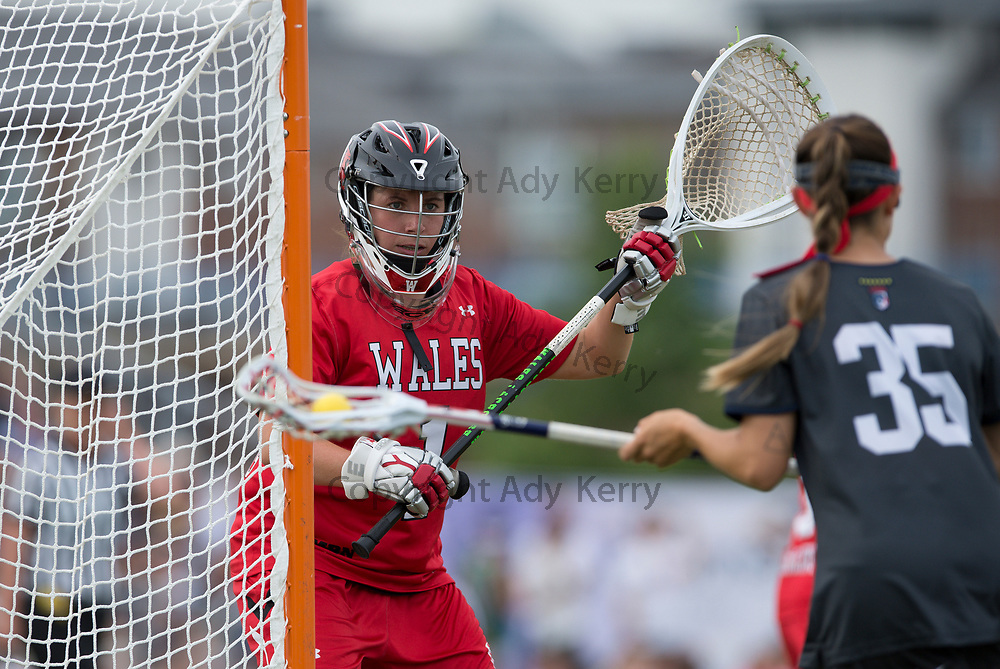 Wales' Erin Walter-Williams watches USA's Michelle Tumolo at the 2017 FIL Rathbones Women's Lacrosse World Cup, at Surrey Sports Park, Guildford, Surrey, UK, 18th July 2017.