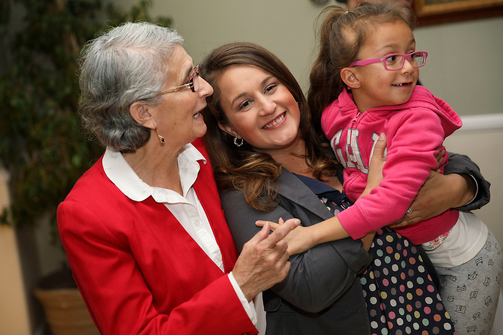 Candidate Imelda Padilla holds nice Angelina Lepe, 6 in pink, with her mother Gliceria Padilla, left in red, during an LAUSD School Board District 6 election night event for candidate Imelda Padilla at Buon Gusto Ristorante on Tuesday, May 16, 2017 in Mission Hills, Calif. Candidates backed by charter school supporters won their first majority on the Los Angeles Board of Education as Kelly Gonez - a teacher at a charter school - collected more votes than Imelda Padilla to win District 6. © 2017 Patrick T. Fallon