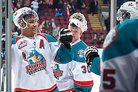 KELOWNA, CANADA - JANUARY 22: Tyrell Goulbourne #12 of the Kelowna Rockets celebrates the win with teammates as he exits the ice against the Everett Silvertips on January 22, 2014 at Prospera Place in Kelowna, British Columbia, Canada.   (Photo by Marissa Baecker/Getty Images)  *** Local Caption *** Tyrell Goulbourne;