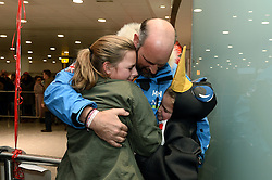 Ed Parker, Co-Founder of Walking with the Wounded and Team Mentor returns home to be greeted by his two daughters Kitty, 14, (left) and Olivia ,11 (right).<br /> The Walking With the Wounded South Pole Allied Challenge 2013 teams return to Heathrow Airport after successfully reaching the South Pole.<br />  Monday, 23rd December 2013. Picture by Ben Stevens / i-Images