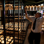 San Juan, TX / 2006 - Alberto Vento, a sacristan at the Basilica of Our Lady of San Juan, tends to the candle room during Easter mass Sunday afternoon.  According to Vento, the room can hold approximately 2,000 lit candles at a time. Photo by Mike Roy / The Monitor