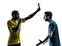 two men soccer player and referee showing red card in silhouette on white background