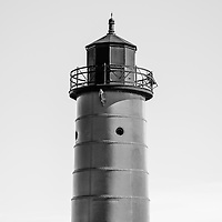 Great Lakes lighthouse photo of Milwaukee Pierhead Lighthouse in Milwaukee Wisconsin. Image is high resolution and black and white. The historic lighthouse is located on Lake Michigan one of the in the United States.