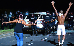 September 20, 2016 - Charlotte, North Carolina, U.S. - Protestors approach CMPD officers on Old Concord Rd. on Tuesday nigh. The protest began on Old Concord Road at Bonnie Lane, where a Charlotte-Mecklenburg police officer fatally shot a man in the parking lot of The Village at College Downs apartment complex Tuesday afternoon. The man who died was identified late Tuesday as Keith Scott, 43, and the officer who fired the fatal shot was CMPD Officer Brentley Vinson. (Credit Image: © Jeff Siner/TNS via ZUMA Wire)