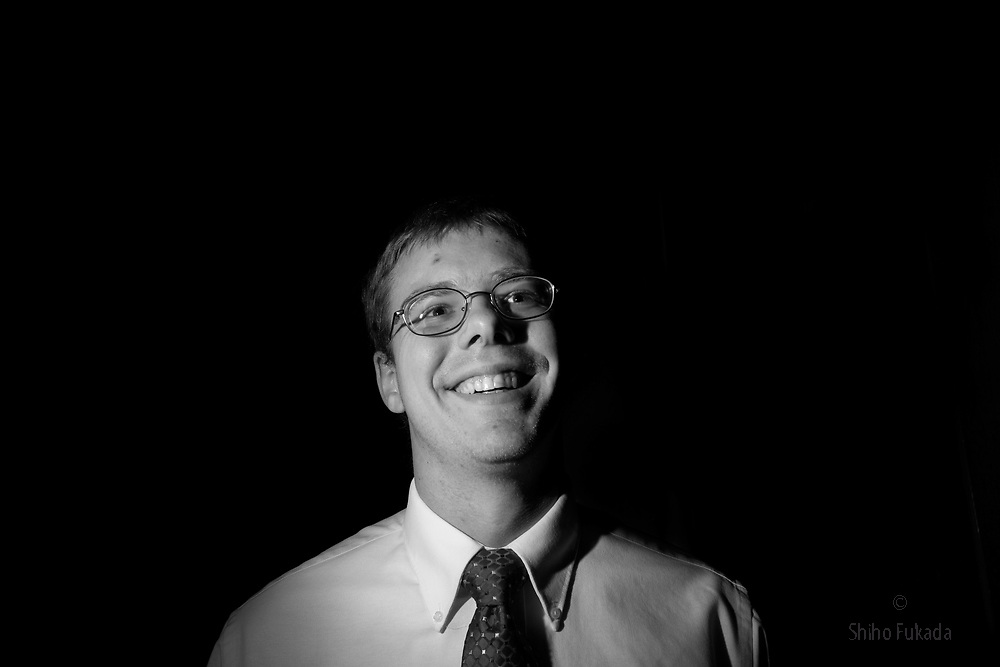 """Jared Cave, 24, a supporter of U.S. Republican Presidential candidate Ron Paul, smiles as he listens Paul speak, October 28, 2007 in Ames,  Iowa. Cave supports Ron Paul because of his foreign policy and says """"I like him because he speaks his mind and stands by his belief."""""""