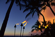 Tiki torches at sunset<br />