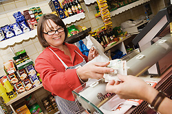 Customer paying for shopping in Polish Delicatessen,