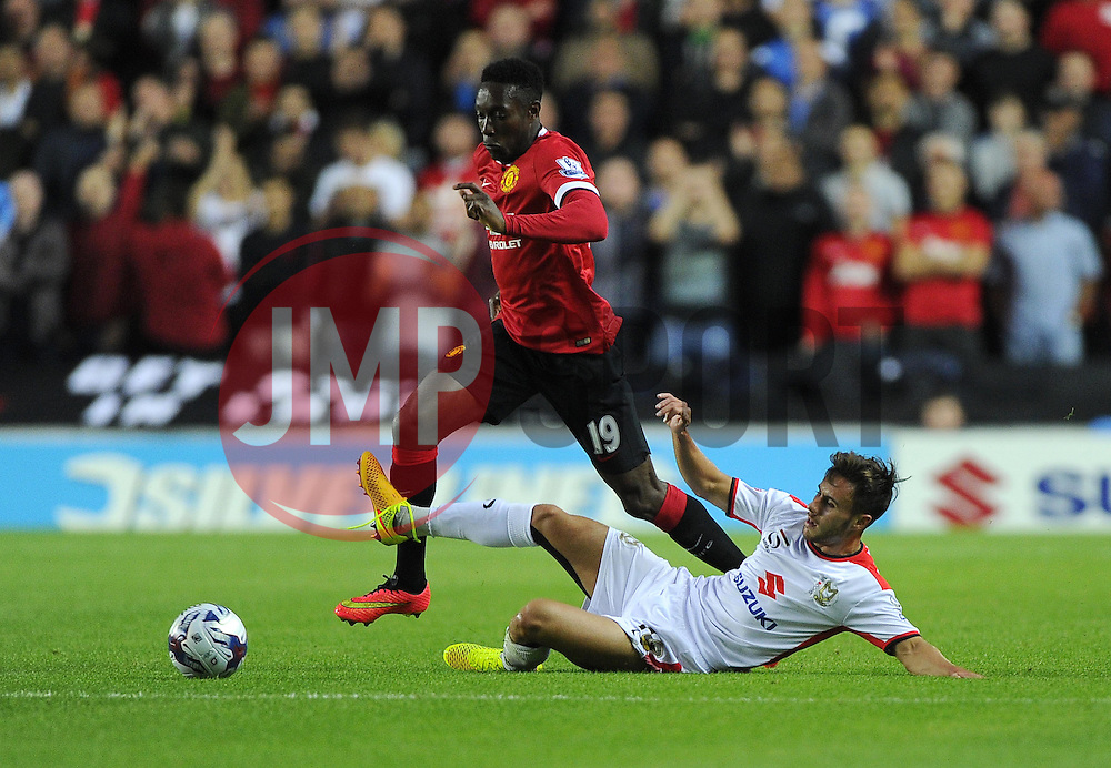 Milton Keynes Dons' George Baldock tackles Manchester United's Danny Welbeck - Photo mandatory by-line: Joe Meredith/JMP - Mobile: 07966 386802 26/08/2014 - SPORT - FOOTBALL - Milton Keynes - Stadium MK - Milton Keynes Dons v Manchester United - Capital One Cup