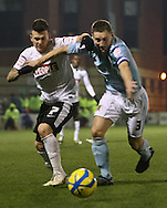 Picture by David Horn/Focus Images Ltd +44 7545 970036.15/01/2013.Dean Cox of Leyton Orient and Andy Dawson of Hull City during the The FA Cup match at the Matchroom Stadium, London.