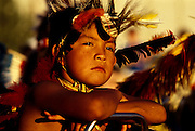 THIS PHOTO IS AVAILABLE FOR WEB DOWNLOAD ONLY. PLEASE CONTACT US FOR A LARGER PHOTO. Native American Indian child with feathers on head at sunset.  MR