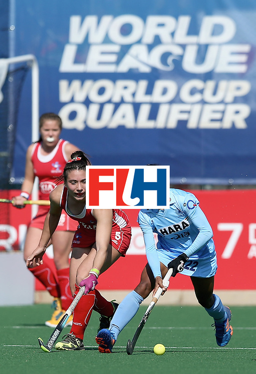 JOHANNESBURG, SOUTH AFRICA - JULY 12: Anupa Barla of India and Denise Krimerman of Chile battle for possession during day 3 of the FIH Hockey World League Semi Finals Pool B match between India and Chile at Wits University on July 12, 2017 in Johannesburg, South Africa. (Photo by Jan Kruger/Getty Images for FIH)