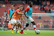 Arsenal's Jack Wilshere challenging Arsenal's Danny Welbeck  during pre-match training before k/o.Barclays Premier league match, Arsenal v Manchester city at the Emirates Stadium in London on Saturday 13th Sept 2014.<br /> pic by John Patrick Fletcher, Andrew Orchard sports photography.
