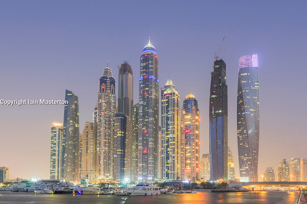 Night view of skyline of modern skyscrapers in Marina district of Dubai United Arab Emirates