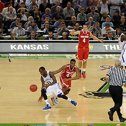 Mar 31, 2012; New Orleans, LA, USA; Kansas Jayhawks guard Tyshawn Taylor (10) steals the ball from Ohio State Buckeyes guard William Buford (44) during the second half in the semifinals of the 2012 NCAA men's basketball Final Four at the Mercedes-Benz Superdome. Kansas defeated Ohio State 64-62.  Mandatory Credit: Derick E. Hingle-US PRESSWIRE