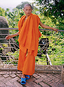 Monk with blue rubber sandals.