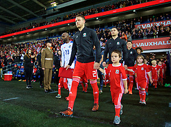 CARDIFF, WALES - Tuesday, November 14, 2017: Wales' captain Chris Gunter leads his sid out, winning his 85th cap, before the international friendly match between Wales and Panama at the Cardiff City Stadium. (Pic by David Rawcliffe/Propaganda)
