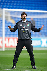 CARDIFF, WALES - Monday, October 15, 2012: Wales' manager Chris Coleman during a training session at the Cardiff City Stadium ahead of the Brazil 2014 FIFA World Cup Qualifying Group A match against Croatia. (Pic by David Rawcliffe/Propaganda)