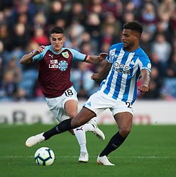 Ashley Westwood of Burnley (L) and Steve Mounie of Huddersfield Town in action - Mandatory by-line: Jack Phillips/JMP - 06/10/2018 - FOOTBALL - Turf Moor - Burnley, England - Burnley v Huddersfield Town - English Premier League