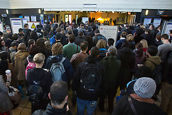 © under license to London News Pictures. 02/01/14. An average 2.8% increase in rail fares comes into effect on Thursday 2nd Jan 2014, pushing the cost of some commuter travel to more than £5,000 a year. FILE PICTURE DATED: 28/10/2013. Commuters queueing for Piccadilly line service of the London Underground whilst severe delays affecting the service due to obstacles on tracks caused by St Jude's Day Storm on Monday, 28 October 2013. Photo credit: Tolga Akmen/LNP