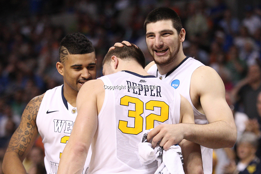 Mar 17, 2011; Tampa, FL, USA; West Virginia Mountaineers guard Dalton Pepper (32) celebrates with guard Casey Mitchell (left) and forward Deniz Kilicli (right) during the second half of the second round of the 2011 NCAA men's basketball tournament at the St. Pete Times Forum. West Virginia defeated Clemson 84-76.  Mandatory Credit: Derick E. Hingle