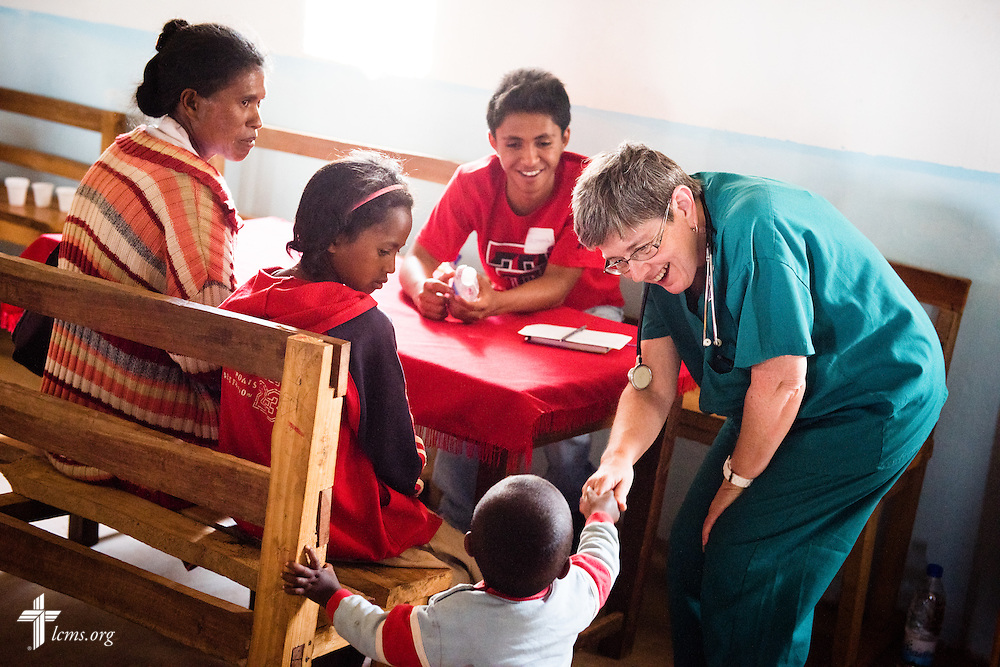 LaDonna Smith greets a new patient at the Mercy Medical Team clinic on Saturday, Oct. 18, 2014, at a Fiangonana Loterana Malagasy (FLM) Lutheran church in Antsoantany, Madagascar. Behind LaDonna is <br /> Solomona John Rakotonirina. LCMS Communications/Erik M. Lunsford