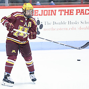 Ben Marshall #10 of the Minnesota Gophers warms up on the ice prior to the game against the Northeastern Huskies at Matthews Arena on November 29, 2014 in Boston, Massachusetts. (Photo by Elan Kawesch)