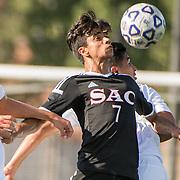 #7 Uriel Regolar from SAC holds off Orange Coast defenders at sac on Friday 4 2016