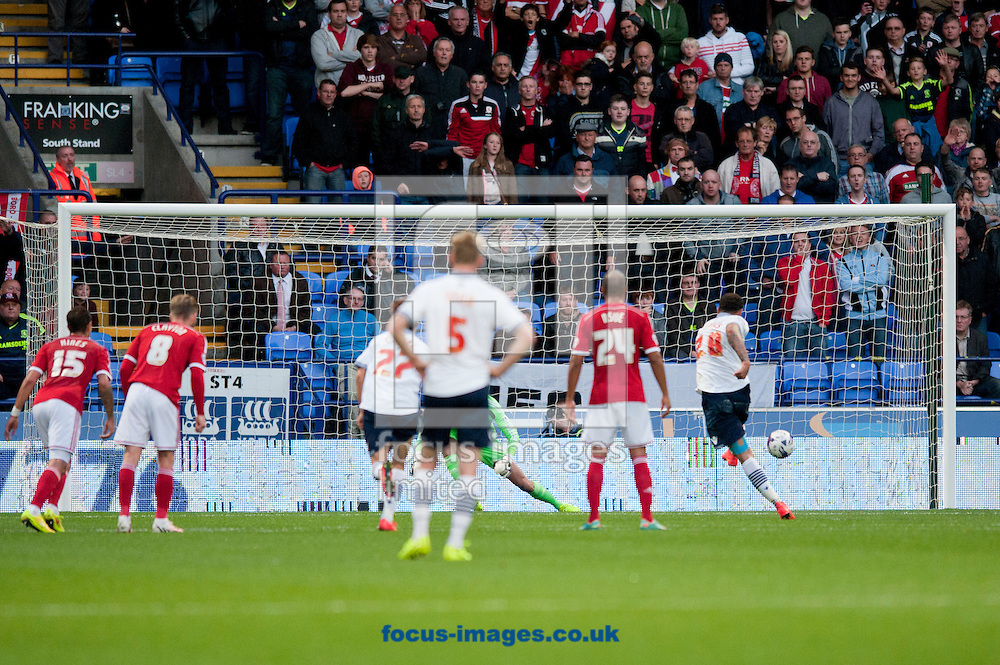 Craig Davies of Bolton Wanderers scores his penalty to make it 1-0 during the Sky Bet Championship match at the Macron Stadium, Bolton<br /> Picture by Russell Hart/Focus Images Ltd 07791 688 420<br /> 19/08/2014
