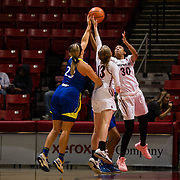 24 February 2018: The San Diego State women's basketball team closes out it's home schedule of the regular season Saturday afternoon against San Jose State. San Diego State Aztecs guards Cheyenne Greenhouse (30) and Allison Brown (13) battle San Jose State forward Hallie Bennett for a rebound in the first quarter. At halftime the Aztecs lead the Spartans 36-33 at Viejas Arena.<br /> More game action at sdsuaztecphotos.com