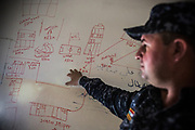 An Iraqi Federal Police officer shows a map of ISIS position at one of sniper's position at a front-line in west mosul.<br />