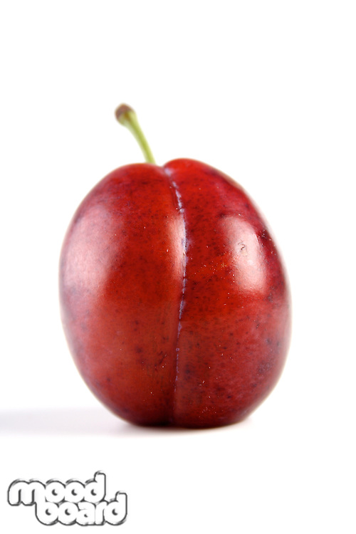 Plum on white background - close up